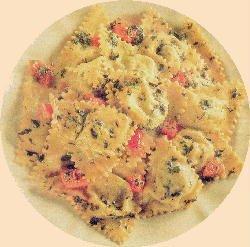 Pansotis, panzerotti rellenos de espinaca y salsa de nueces